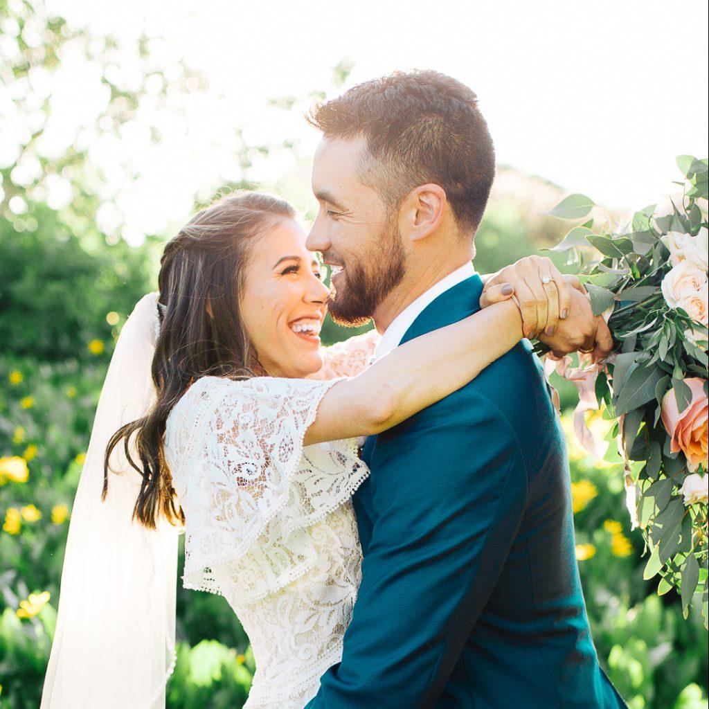 Utah Photography of a bride and groom in wildflowers